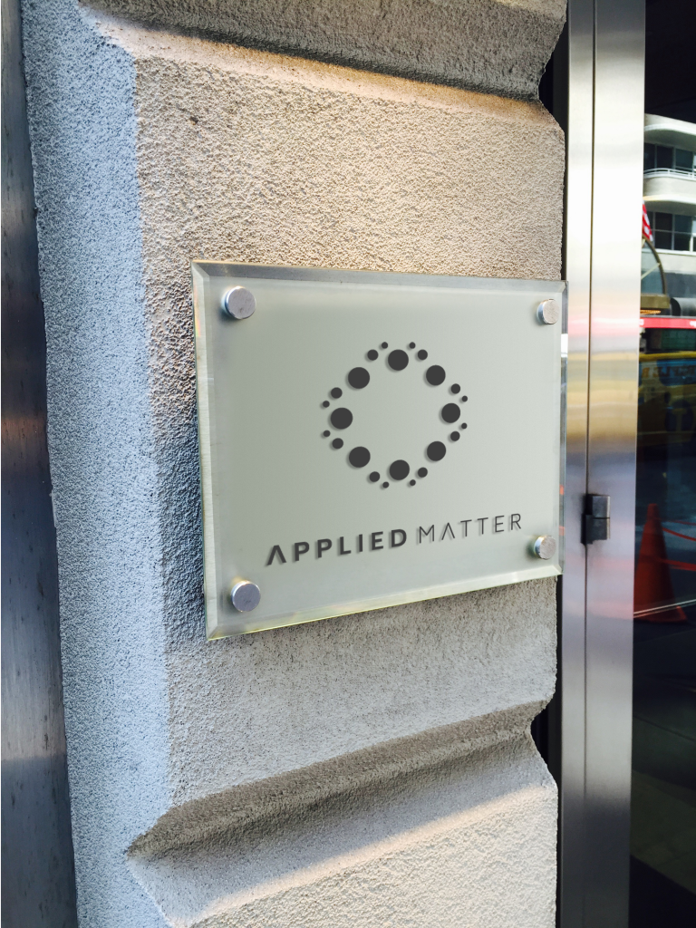 Applied Matter Office Building Logo